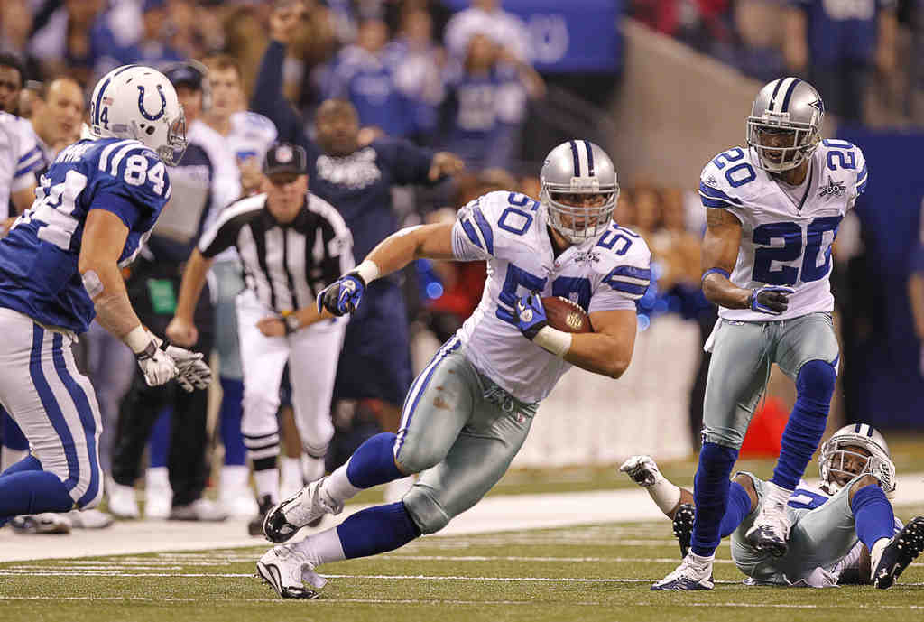 Cowboys linebacker Sean Lee returns an interception of the Colts´ Peyton Manning for a score. Dallas, once 1-7, will host the Eagles on Sunday having won three of its last four games.