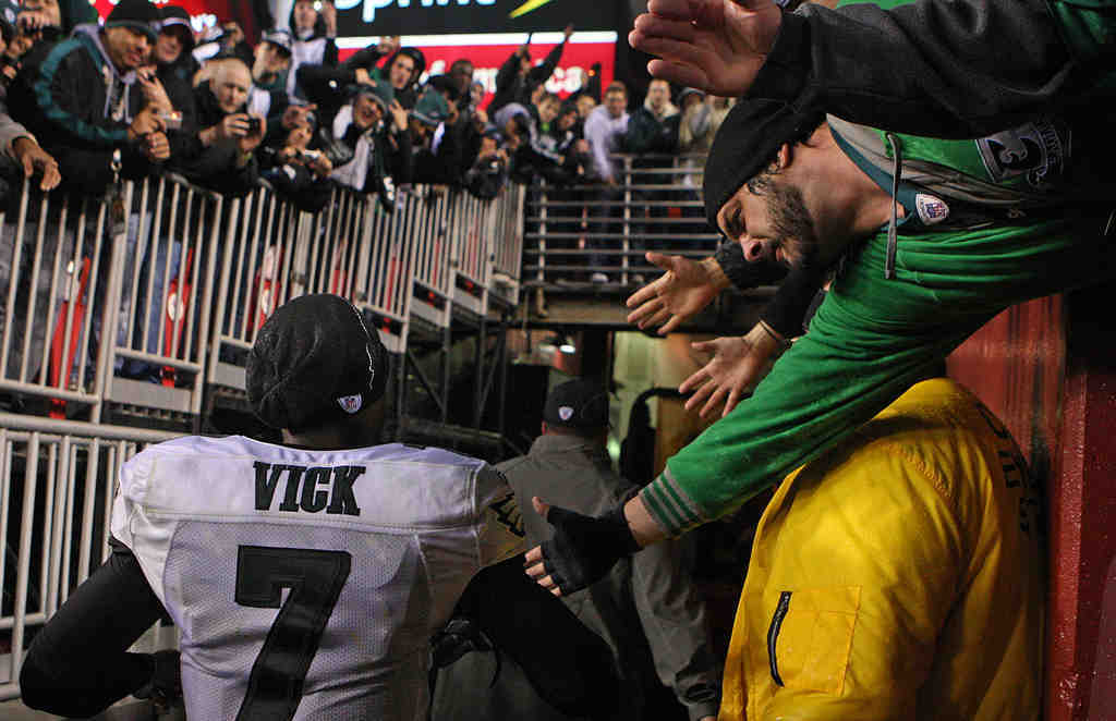 Fans reach out to Eagles QB Michael Vick after the Birds beat the Redskins last month.