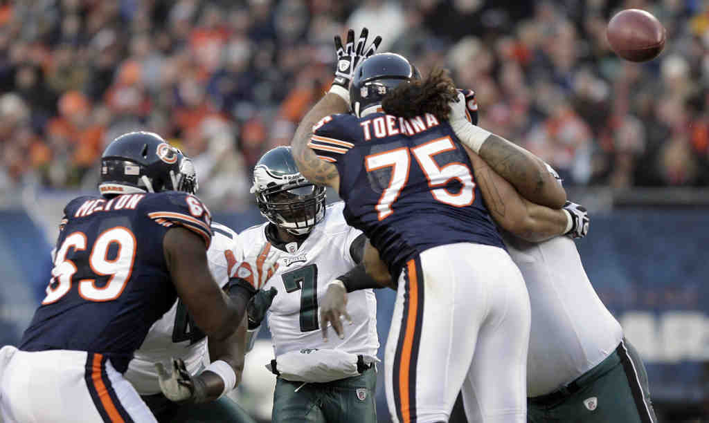 Quarterback Michael Vick gets pressure from the Chicago Bears. He has complained about getting hit late by defenders, saying it has begun to wear on him.