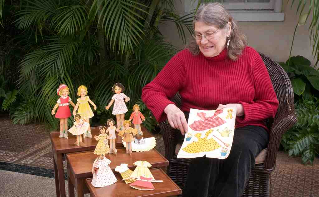 Carlene Bausch Moscatt of Baltimore treasures the paper dolls she received from the du Pontsat Christmas. Her father was a gardener on the estate; her mother was Alice du Pont´s maid.
