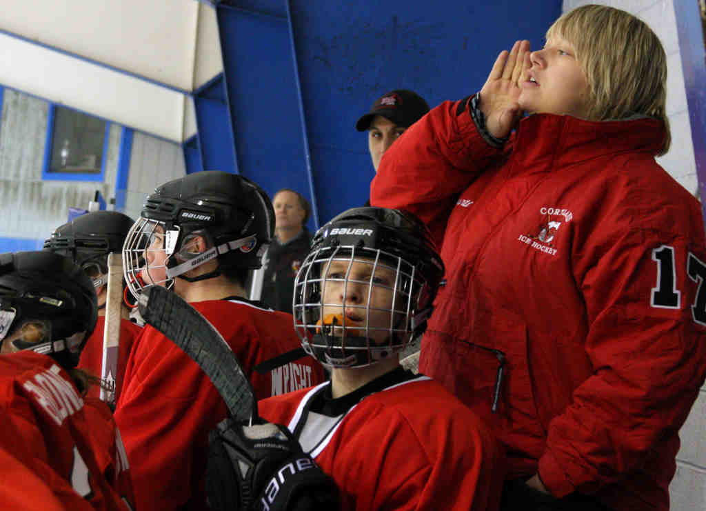 Hatboro-Horsham´s Tricia Silvestri shouts instructions to her team from the bench. She is the first female varsity head coach in the 38-year history of the Suburban High School Hockey League.