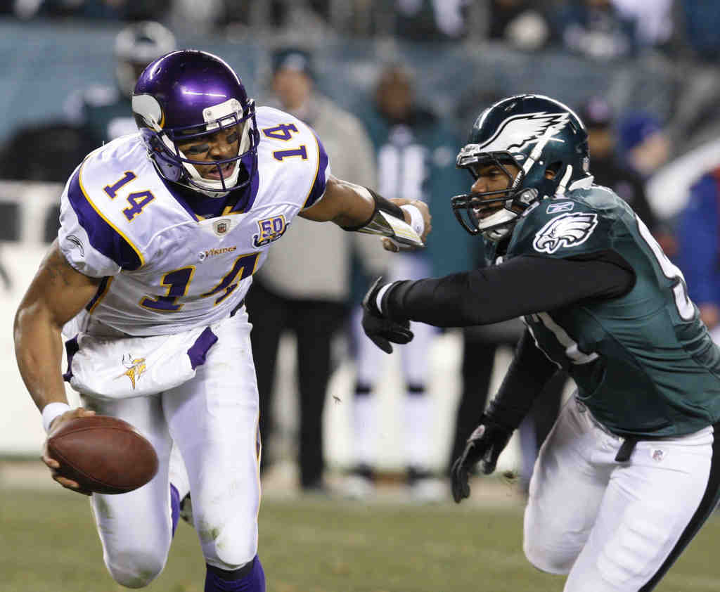 Vikings quarterback Joe Webb eludes a sack attempt by the Eagles´ Darryl Tapp. Webb was making his first NFL start.