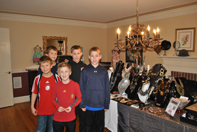 (left to right) Wayne Elementary School third grader Casey Ott, fifth grader Ethan Ott, first grader Alex Herrmann and fifth graders John and Rob Herrmann next to the vending stand for Gracelina accessories.