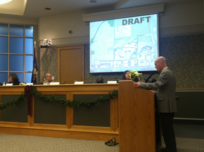 Lower Merion Director of Building and Planning Bob Duncan presents the City Avenue rezoning ordinance to the board and a mix of pro-and anti-ordinance audience members.