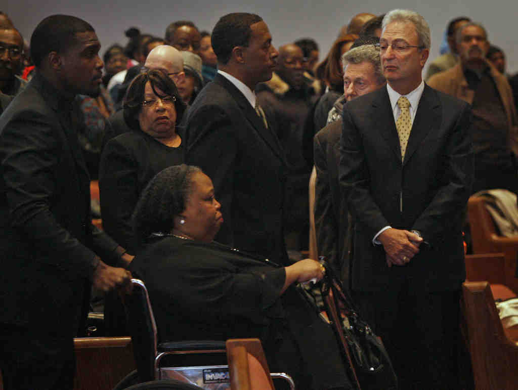Karen James, widow of Benny Briscoe, enters service for the boxer Monday at Deliverance Evangelistic Church.