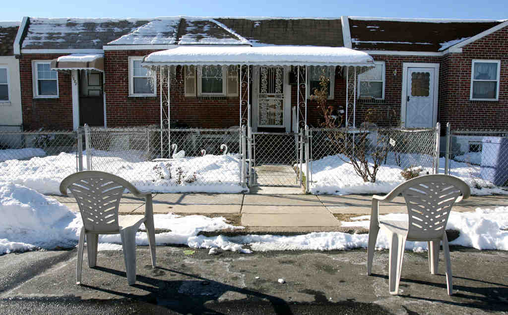 Patio chairs reserve a shoveled-out parking space in Darby Township. Officials plan to levy fines of $300 to $1,000 on those who save spots with chairs, trash cans, or other obstructions.