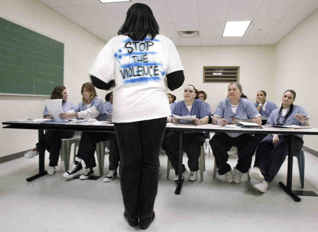 Teyne Crum of Mothers in Charge leads a session for female inmates at the Riverside Correctional Facility in Philadelphia.