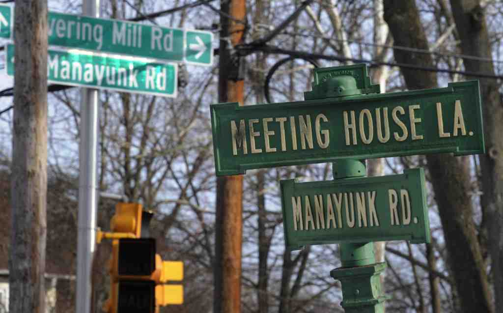 Historic signs coexist with modern ones near Cynwyd Elementary School. Lower Merion will seek a waiver from federal recommendations.