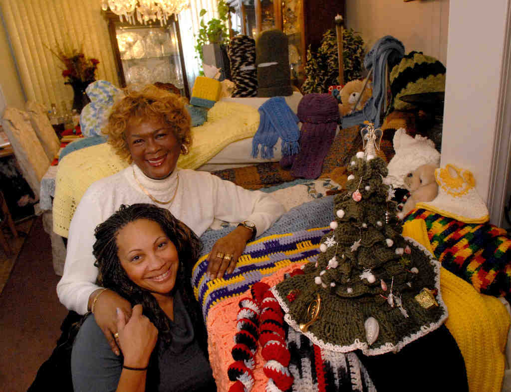 Delorise Easley-Williams with her daughter, Venus M. Jackson, and many of the items she´s crocheted, including a Christmas tree in the foreground.