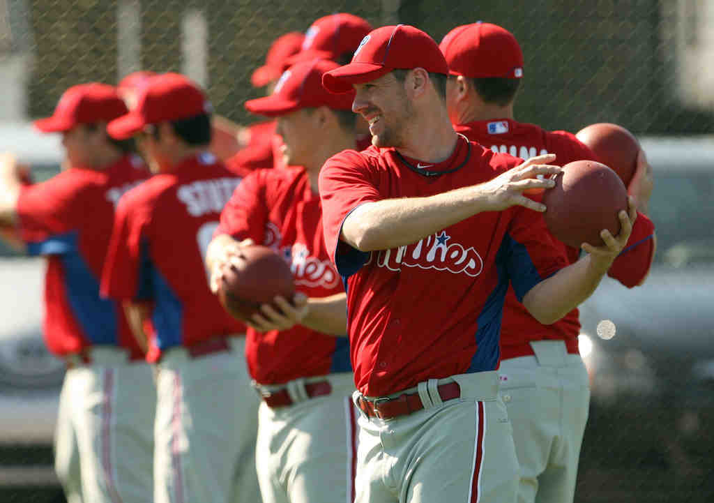 Cliff Lee lines up with other pitchers during a training camp workout.