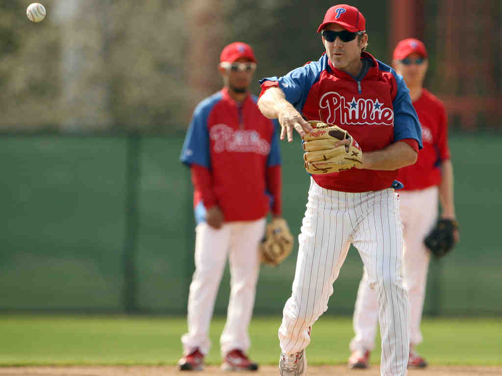 Second baseman Chase Utley throws during fielding drills in Clearwater, Fla. For the Phillies to win, he needs to stay healthy.