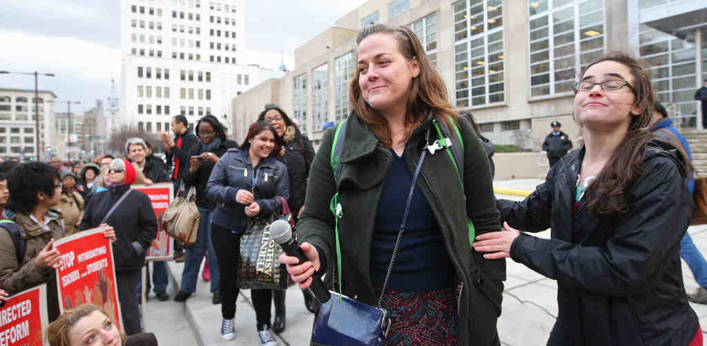 Phila. teacher Hope Moffett (left), who might lose her job for speaking out, addressing protesters at School District headquarters last Friday. With her is teacher Bridget Finnegan.