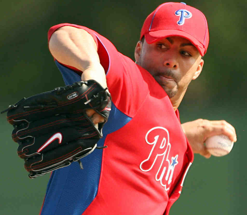 Reliever J.C. Romero took a substantial pay cut and returned to the Phillies.