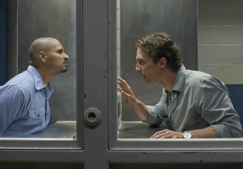 "Michael Peña (left), Matthew McConaughey in ""The Linc- oln Lawyer,"" with Bryan Cranston, Marisa Tomei."
