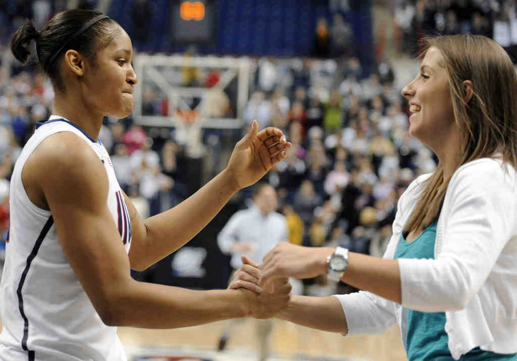 UConn teammate Caroline Doty, who has been sidelined by injury, congratulates Maya Moore.