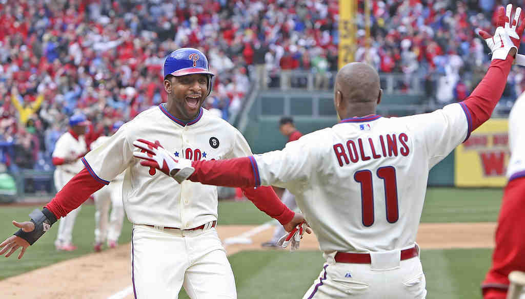 Ben Francisco is greeted by Jimmy Rollins after scoring the game-winning run on John Mayberry Jr.´s walk-off single in the ninth.