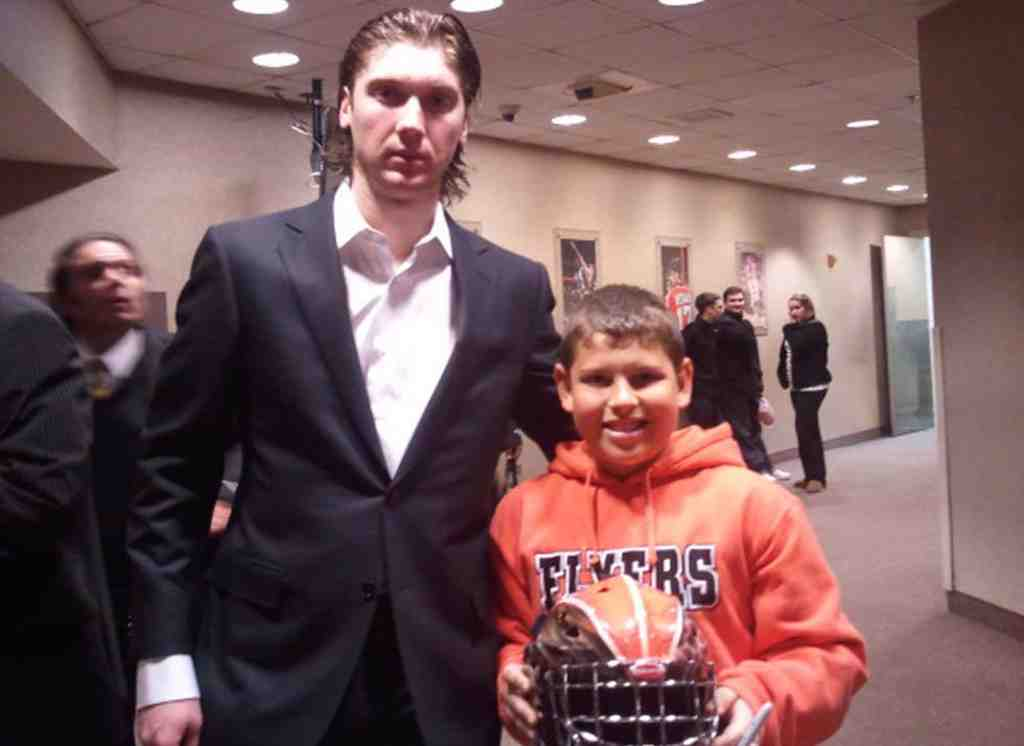 "Beaming over an early birthday gift from his dad, Nick Lopez, turning 13, meets Flyers goalie Sergei ""Bob"" Bobrovsky."