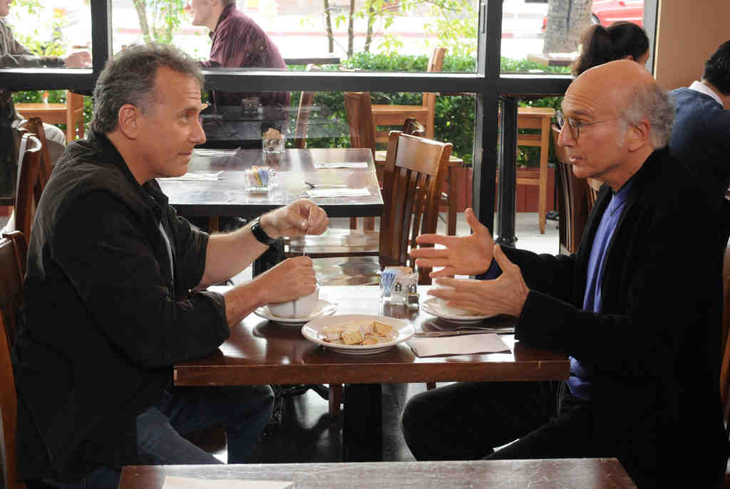 """In an episode of """"The Paul Reiser Show,"""" Paul Reiser´s character Paul (left) schedules a meeting with """"Curb Your Enthusiasm´s"""" feckless Larry David character, played by Larry David. Reiser´s copycat is better than most TV sitcoms, but it doesn´t rise to others´ level of cracked originality."""
