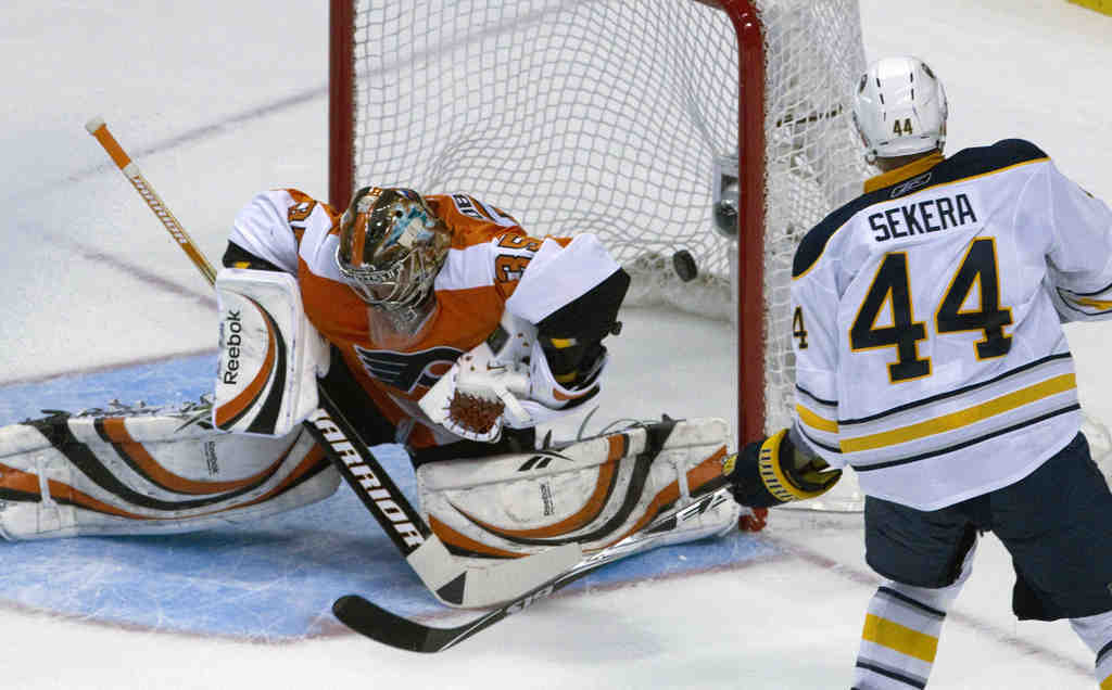 Buffalo´s Andrej Sekera scores past the Flyers´ Sergei Bobrovsky for the Sabres´ third goal.