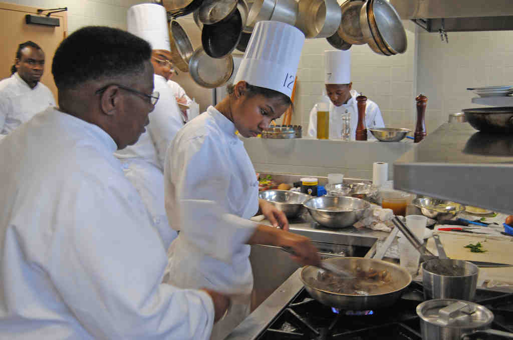 Chef Wilhelmina Bell with Dobbins student Brianna Wellmon. The Careers Through Culinary Arts Program got $15,000 last year, and probably nothing next year.