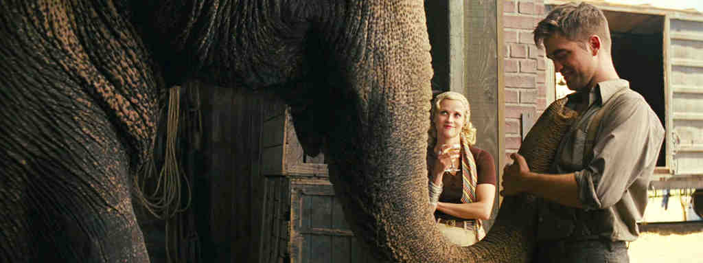 "Robert Pattinson and Reese Witherspoon in a scene from ""Water for Elephants."" She plays an equestrian, he a circus veterinarian who pines to rescue her from her abusive husband, the circus owner."