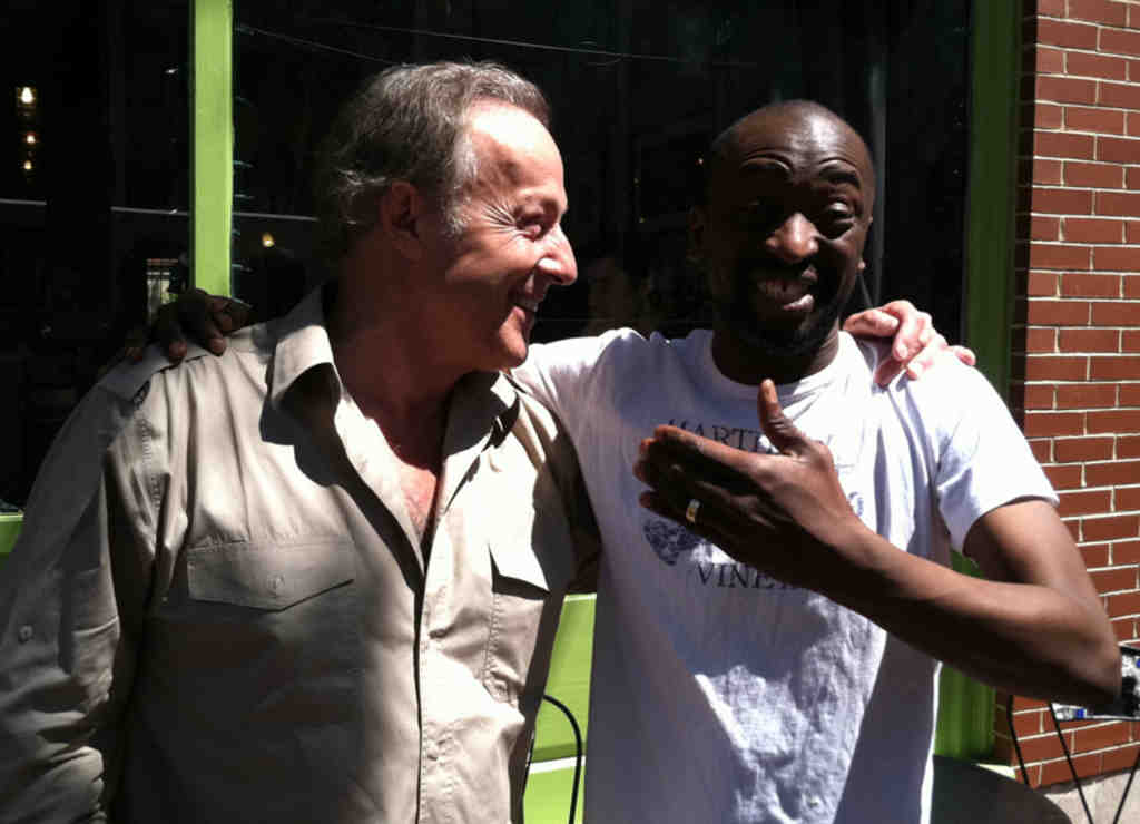 TV host Gérard Klein (left) was all ears when Jean-Luc Fanny emerged from his Spring Garden cafe to tell his story in French.