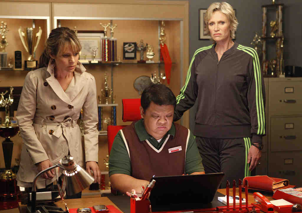 """Jane Lynch (right) , as Sue, with Jessalyn Gilsig and Kent Avenido on """"Glee."""" A soft Sue was annoying."""