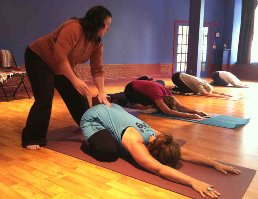 "Mary Kate Farley adjusts the posture of Robyn Evans during Freedom Yoga at the Soul Center. ""The result of surrendering to what´s happening in the moment is a feeling of peace,"" she says."