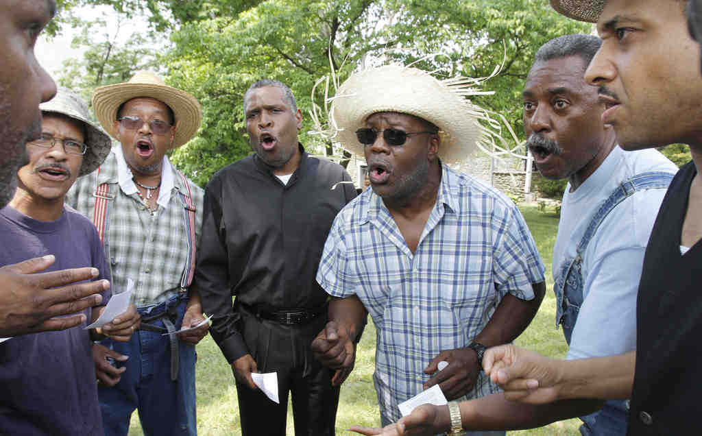 """The Enon Tabernacle Baptist Church Mighty Male Chorus rehearses """"People Get Ready"""" at the Johnson House on Germantown Avenue, once a station on the Underground Railroad."""