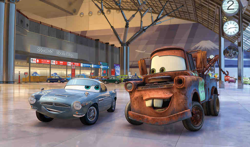 "A tow truck voiced by Larry the Cable Guy cozies up to a sports car in ""Cars 2."""