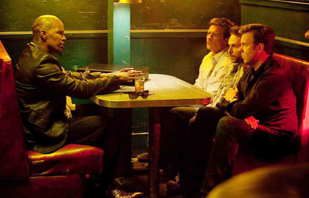 "Jamie Foxx (left) and the put-upon employees in ""Horrible Bosses"": (from left) Jason Bateman, Charlie Day, and Jason Sudeikis. Bateman is funny, but otherwise the comedy simply doesn´t work."