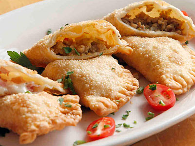 Empanadas stuffed with ham, chicken, and beef at 943. (Akira Suwa / Staff Photographer)