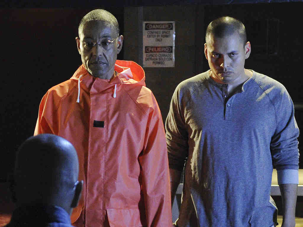 """Giancarlo Esposito (left) and Jeremiah Bitsui in a scene from """"Breaking Bad."""" Esposito describes the character he plays, Gus Fring, as """"a villain with a very strong sense of himself, graceful, polite, kind, a very good businessman and very different from the average Mafia guy."""""""
