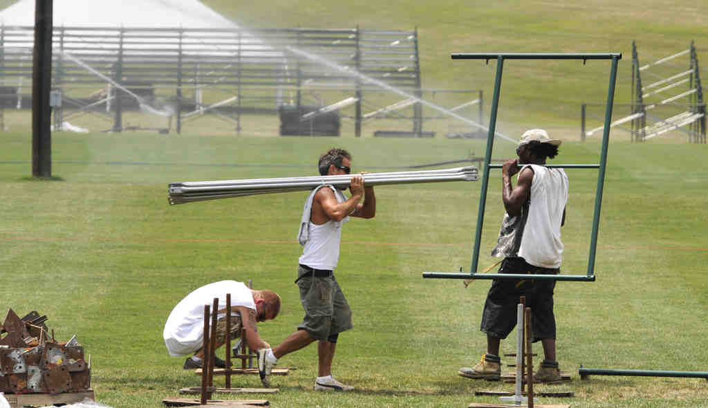 Workers begin erecting bleachers at Lehigh University in anticipation of the opening of Eagles camp, once the lockout is lifted.