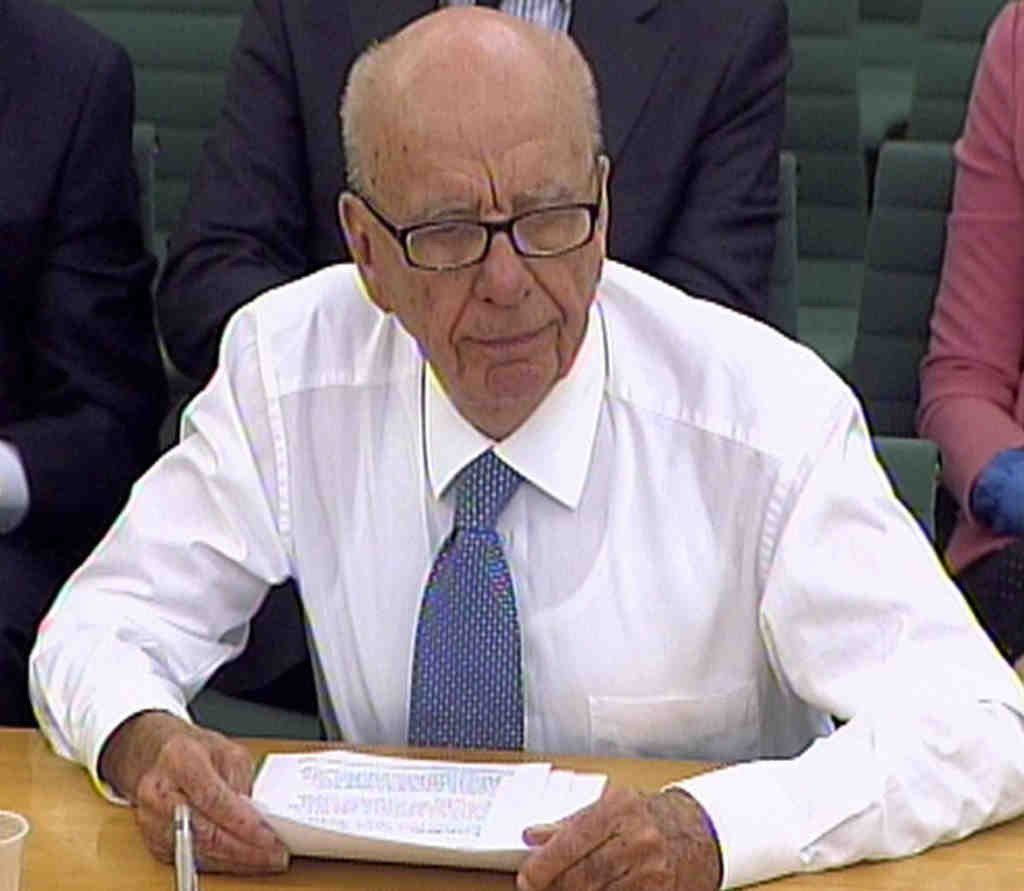 Rupert Murdoch discussing the scandal with a House of Commons committee Tuesday.