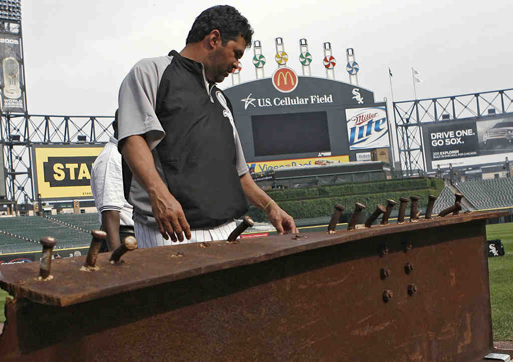 White Sox manager Ozzie Guillen looks at a steel beam from the World Trade Center wreckage, to be displayed in Darien, Ill.
