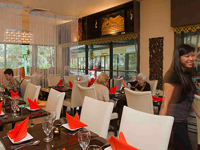 The decor of Chestnut Hill's Thai Kuu, co-owned by Atchara Cooley (right), is white-leather upscale.