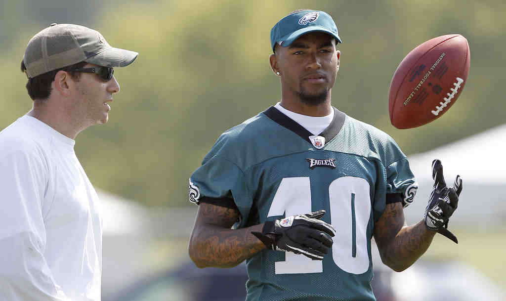 DeSean Jackson visits with general manager Howie Roseman during first practice after holdout.