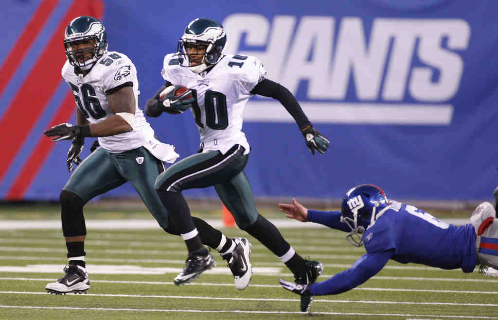 Catch him if you can: DeSean Jackson blows past Giants punter Matt Dodge toward the end zone.