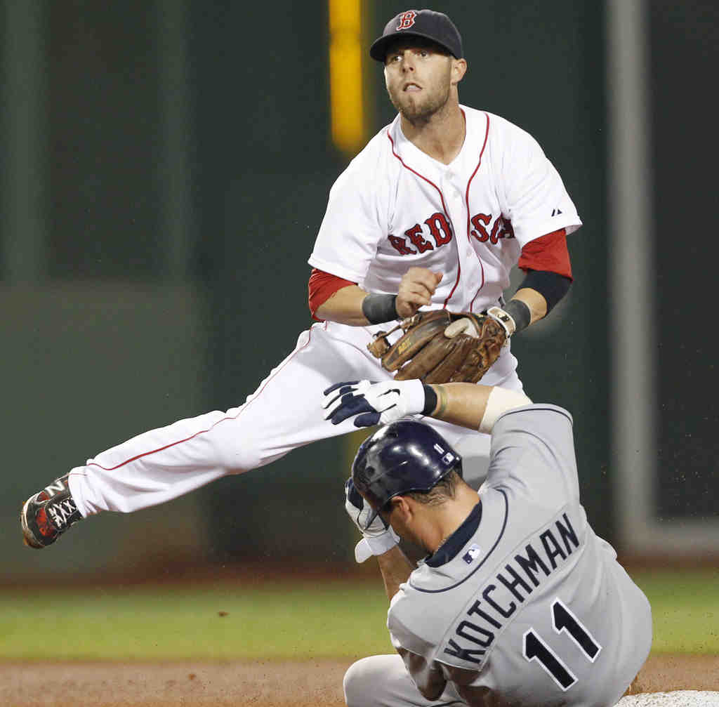 This time, it´s the fielders who are touching ´em all. Boston´s Dustin Pedroia relays to first base to complete a triple play.