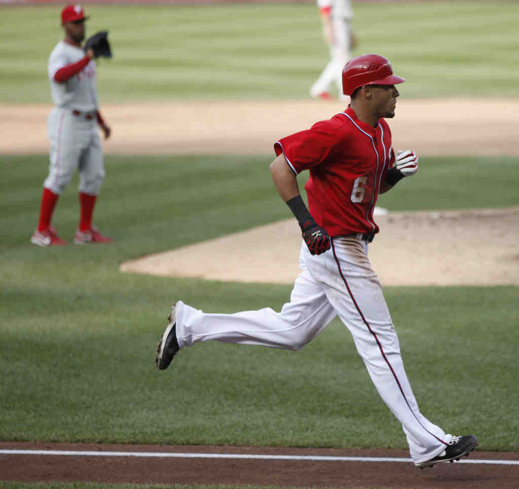 Ian Desmond circles the bases after his two-out, two-strike homer off Antonio Bastardo (background) tied the game for the Nationals in the ninth inning.