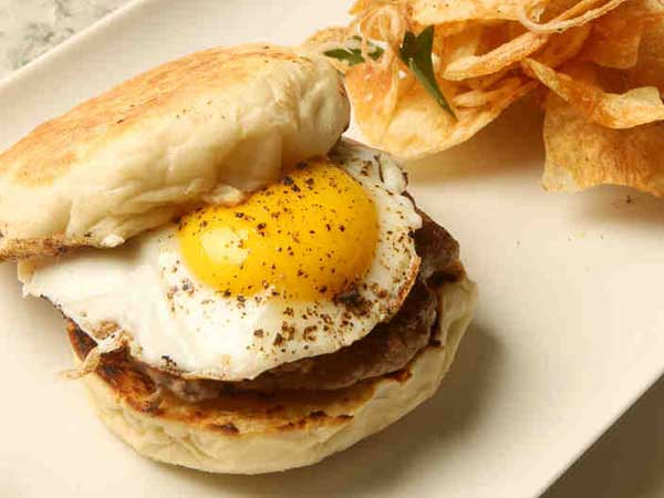 A breakfast sandwich at a.kitchen, in the AKA Rittenhouse Hotel: Fried egg and house-made English muffin.