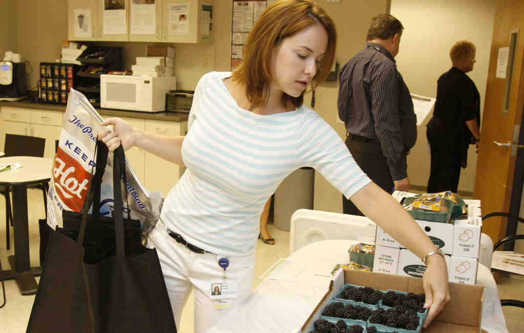 Kathy Walsh picks out a box of blackberries from Lancaster.