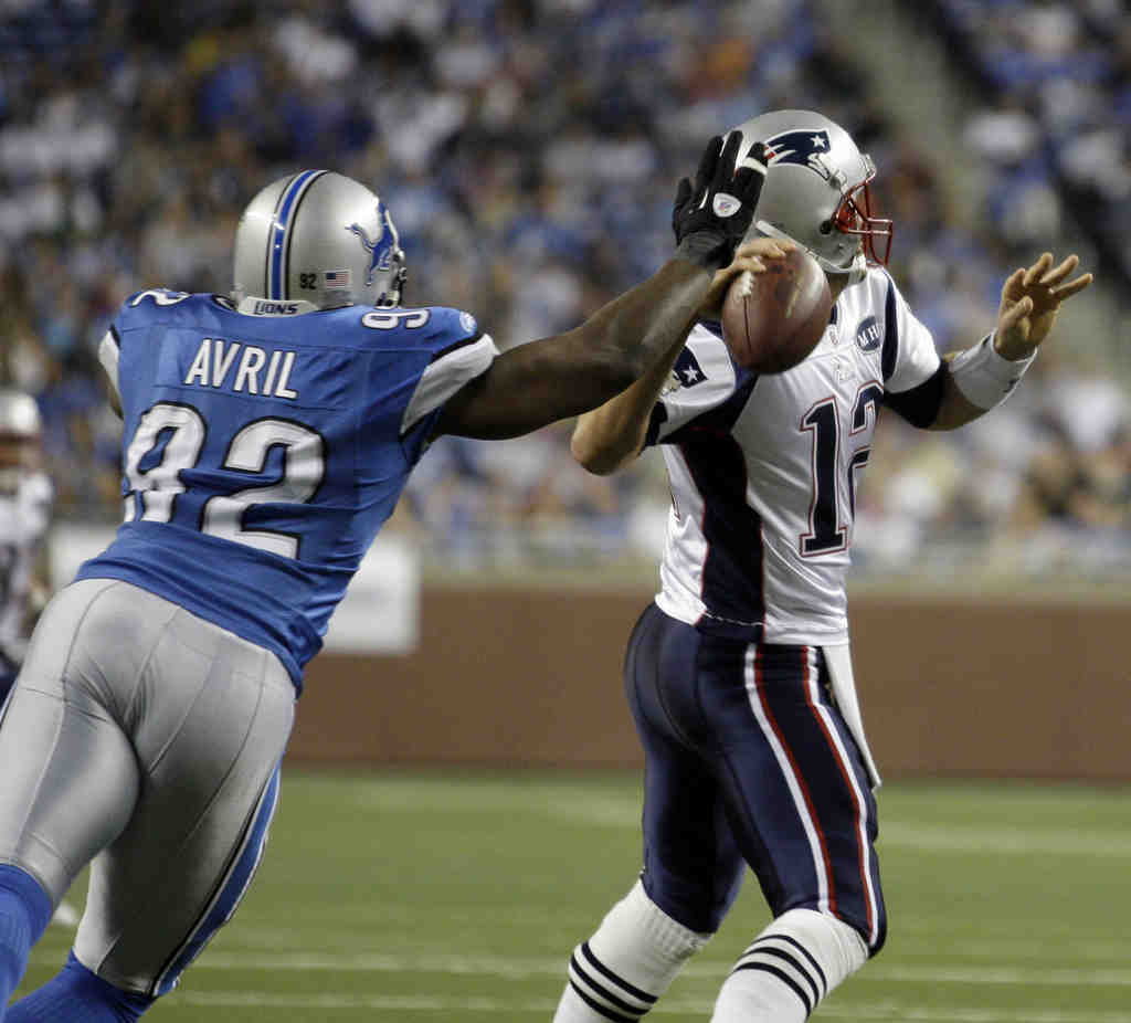 The Lions´ Cliff Avril pressures New England´s Tom Brady on Saturday night. Detroit´s fearsome pass rush harassed the league´s reigning MVP into a tough night in the Lions´ 34-10 victory.