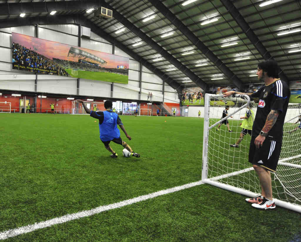 Defender Danny Califf oversees a Union Juniors training session at YSC Sports in Wayne.