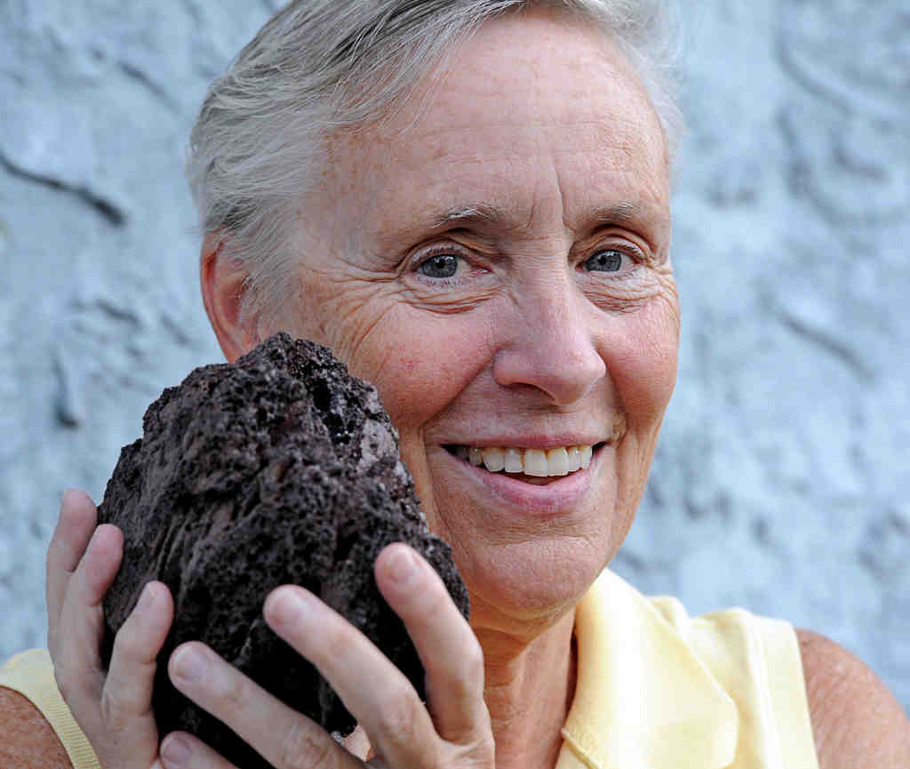 "Judy Michel with a favorite piece of spatter lava from Kilauea: ""Once you stop learning, you´re done."""