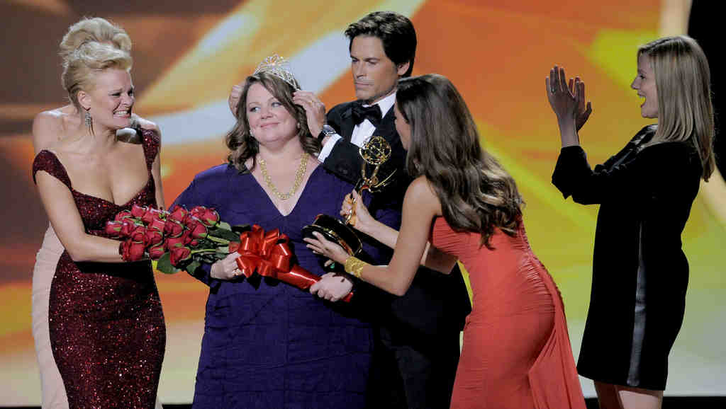 "Rob Lowe crowns Melissa McCarthy, winner for lead actress in a comedy for ""Mike & Molly,""as Sofia Vergara hands her the Emmy. Nearby are Martha Plimpton (left) and Laura Linney."