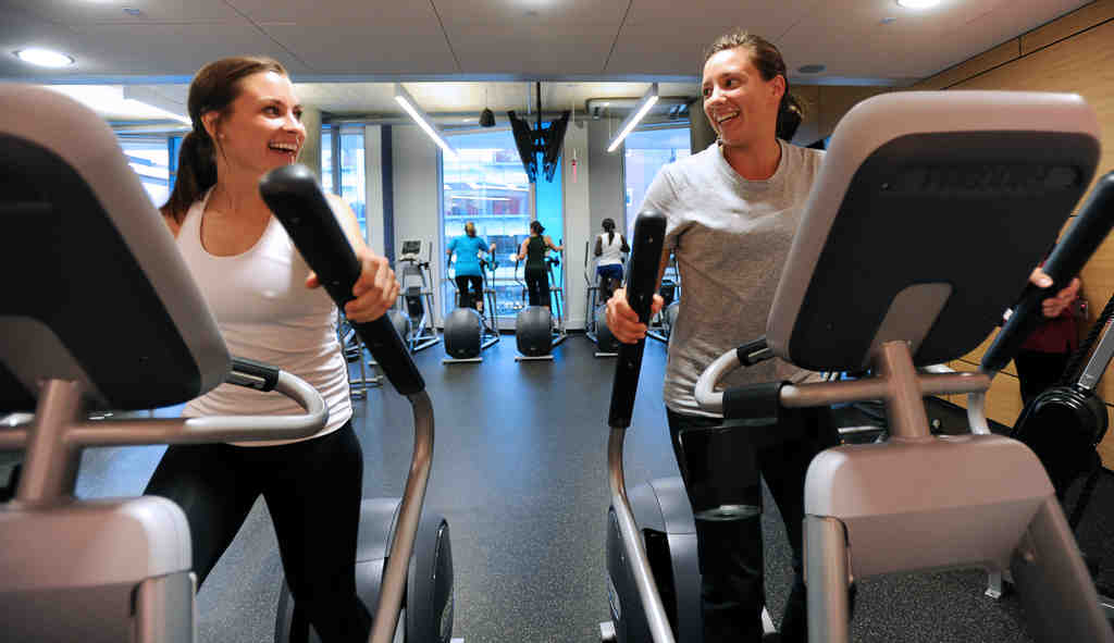 At Drexel University´s recreation center Stephanie Smith (left), 22, a group exercise instructor and graduate student and Jessica Norman, 26, director of health, fitness, and wellness, generate electricity as they exercise together on the elliptical machines.