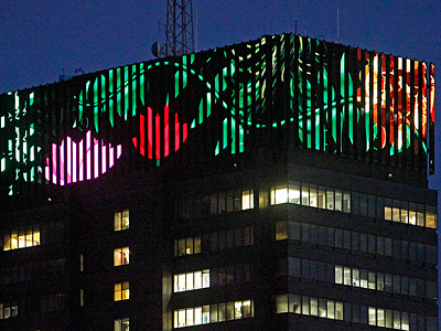 The Peco building displays a moving, colorful image of flowers, leaves, and vines, courtesy of artist Tim Wingert. (Akira Suwa / Staff Photographer)