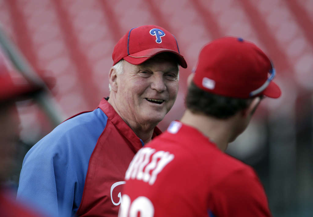 Charlie Manuel smiles as he talks with Chase Utley during Monday´s off-day. The Phils manager relishes in the fun of baseball.